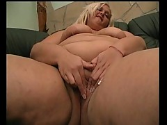 Bbw busty blonde masturbates herself sitting on a sofa!