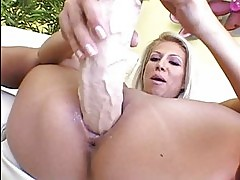 Horny blonde with tanned body taking dildo up her slippery v...