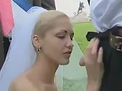 Bride sucks cock in a field on wedding day