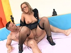 Busty blonde in a cops uniform heels and fishnet stockings fuckin