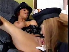 Lesbian cops in gloves fondle and lick pussy