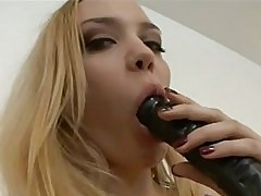 Annette Schwarz deep throats a huge cock and gags as she suc...