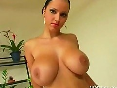 Busty Pornstar teases and rubs her tight pink pussy