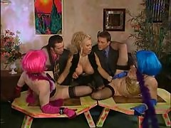 Milf fists two girls as guys watch