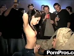Hot horny college slut pulls out her tits and sucks cock for the crowd.