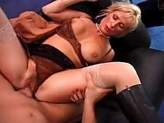 Two Dudes bangs a horny german milf