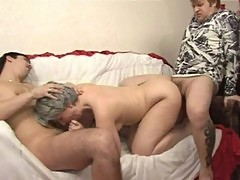 Two boys fucking a grey-haired russian lady