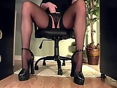 Leggy Nympho Secretary Gets Caught On Cam Masturbating Under The Desk