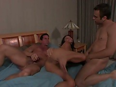 Hot brunette pounded hard by two hard cocks in a hot dp video
