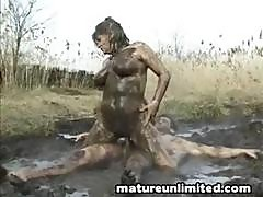 Couple Is Outside And Romping In The Mud As They Fuck Each Other