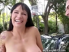 Dirty Brunette MILF On Her Knees Sucking Cock Outdoors