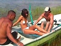 Sexy chick takes two cocks in the boat