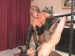 Blonde mistress in high boots makes slave cum in own mouth