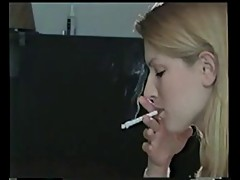 Awesome blonde smoking a cigarette!