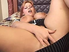 Fat redhead fingers pussy in hotel room