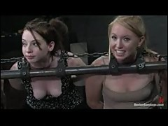 Three chained girls are lightly caned
