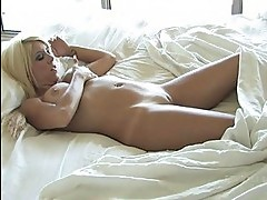 Tess stunning blonde toying pussy and using a vibrator