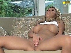 Beautiful blonde Ashlynn Brooke plays with her sweet pussy