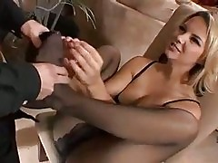 Sexy Ashlynn Brooke giving a nice footjob and blowjob