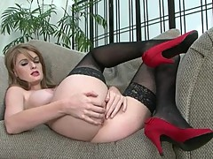 Red headed Faye Reagan fingers herself in stockings and heels