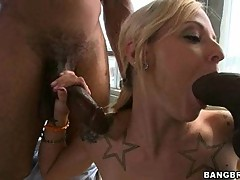 With a cock in each hand, Faye Runaway sucks each cock until they explode