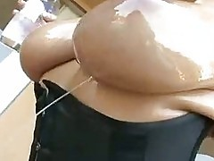 Super Hot Gianna MIchaels gets her big busted boobs oiled
