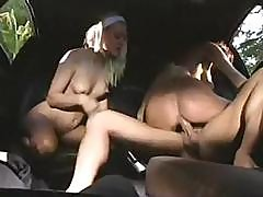 Lanny Barbie Is In A Threesome In A Car With Another Babe