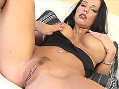 Tittilating Laura Lion gets too hot to handle spreading her shaved slits