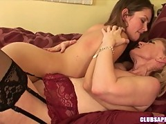 Allie Haze and Nina Hartley caress each others body