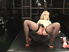 Rampant Nina Hartley fingers her wet pussy lips