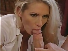 Blonde whore Ryan Conner stuffs her mouth with a thick shaft...