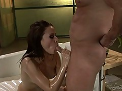 Oiled babe Sindee Jennings gobbles down a stiff cock