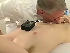 Blindfolded hunk getting his hard cock zapped
