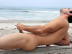 Beach bum Brock Cooper jerks his cock on his boogie board