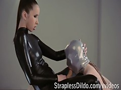 Strapon fucking in spandex catsuit