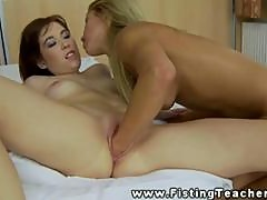 Horny lesbians using toys and fists in tight pussys