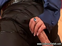 Mumified guy gets a handjob from this sexy classy babe
