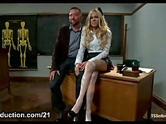 Busty blonde tranny anal fucks her teacher in bdsm action