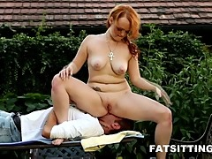 Cute chubby redhead facesitting outdoors