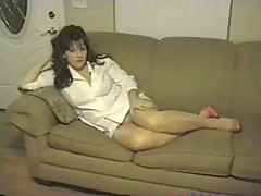 Mature on couch in shiny pantyhose