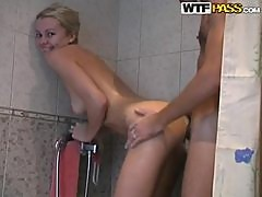 Playful blonde girl gets fucked while taking a shower