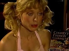 Nina Hartley sucks and rides Peter North's cock in the kitchen