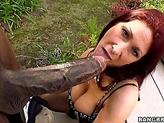 Tiffany Mynx sucks on a huge dick